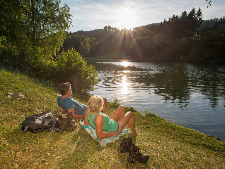 Sunbathing on the Esmecke reservoir near Wenholthausen in the Eslohe holiday region