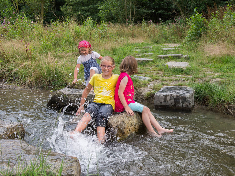 Children play on the river Lenne in Fleckenberg in the Sauerland
