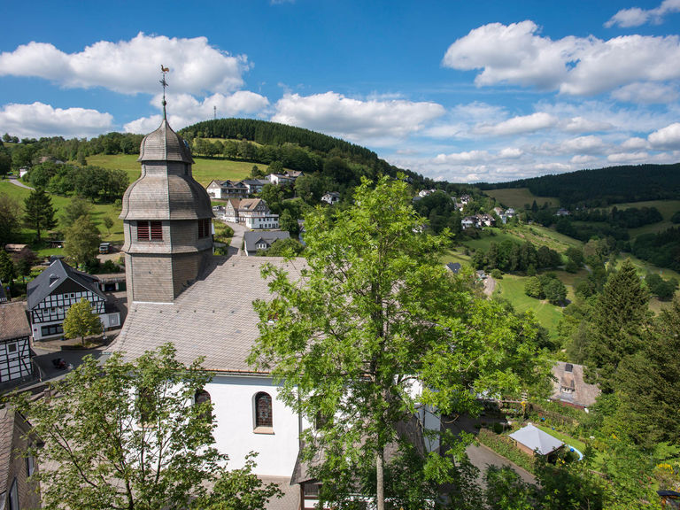 View of the village centre and the church St. Hubertus in Nordenau in Sauerland